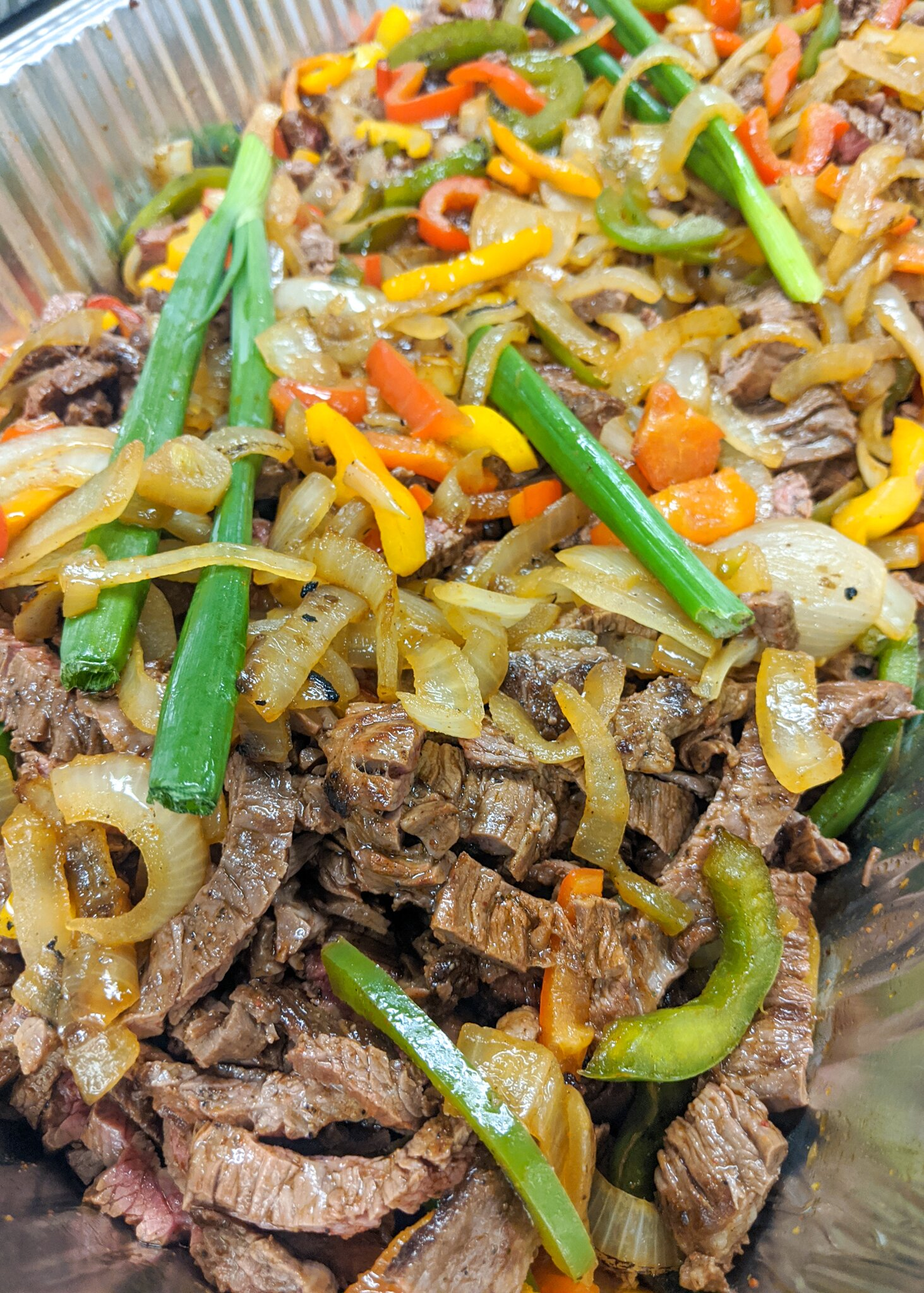 Steak fajitas with onions and peppers}