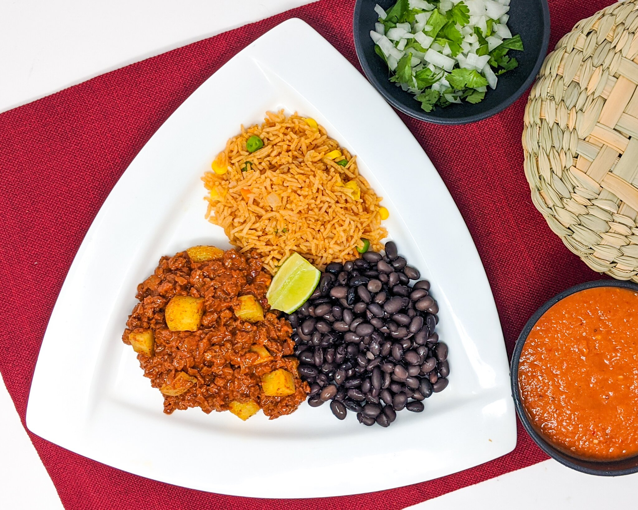 Vegan taco plate with soyrizo, potatoes, rice, beans, and salsa for catering}